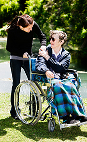 Wheelchair user and caregiver friend