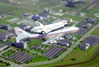 NASA shuttle atop a Beoing 474 in transport