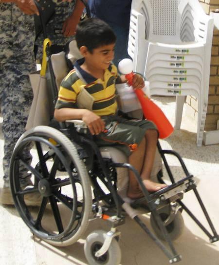Iraqi child in a wheelchair